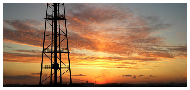 Oil Drill in Field at Dawn