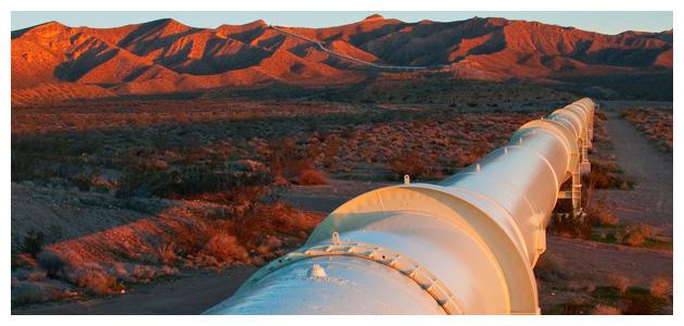 Pipeline Running Through Desert Landscape